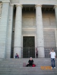 Kathy exhausted on steps of Cathedral after day at Museo del Prado